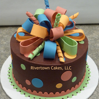 "Present Birthday Cake   8"" Marble cake with chocolate buttercream and fondant accents."