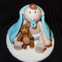 Baby Cake Topper  I made this cake topper for practice. It is made from fondant/gumpaste. First time making a figure like this, just wanted to see if I could...