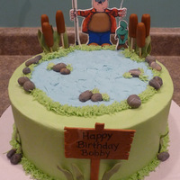 Fishing The fisherman is an edible image applied to fondant. Frosted in buttercream with fondant accents.