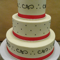 061210 Wedding   Frosted in buttercream with dark pink satin ribbon and fake pearl border, black piping is royal icing