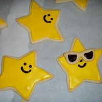 Suns_With_Sunglasses2.jpg  Basic NFSC recipe from CC of course!! I used RI to flood the cookies and a wilton black gel pen to finish them off with a smile! Thank you...