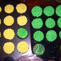 Cousin's Birthday Cupcakes   Yellow cake mix with green and yellow BC...