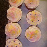 Easter Cupcakes...   Yellow cake with BC icing... Yellow and Pink sparkle dust added!!!