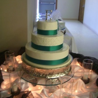 White With Teal Ribbon White cake with raspberry filling. All buttercream, with a satin ribbon border.
