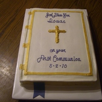 First Communion White cake with buttercream icing. The cross and bookmark are made of fondant.
