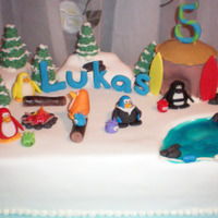 Club Penguin  Vanilla and Chocolate cake covered in Fondant with 50/50 gum paste/fondant accents and some butter cream. I didn't get to completely...