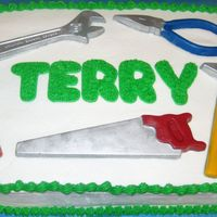 Tool Cake I made the tools out of chocolate.