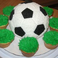 Soccerball Cake With Grass Cupcakes I made this cake for my friends son on his birthday. He requested it after he saw the basketball cake I made. This design was a little...