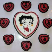 Betty Boop Heart Cake Wih Mini Cakes Betty Boop cake is Confetti, mini Heart cakes are chocolate. The music notes are chocolate. I did the Betty Boop face by doing a pin prick...