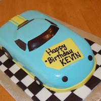 Fondant Racecar Cake. My first attempt at using fondant to cover a shaped cake.