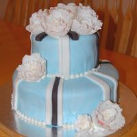 2-Tiered Cake Covered In Fondant And Fantasy Flowers This is my first attempt at a tiered cake and fantasy flowers.