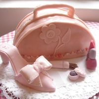 Purse And Shoe Cake This was my first fondant covered cake. Thanks boonenati for the great tutorial and templates.