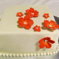 Square Cake With Red Flowers  This cake is a little trial for my cousin's wedding cake. It's orange and almond cake with Grand Marnier truffle filling. It&#039...