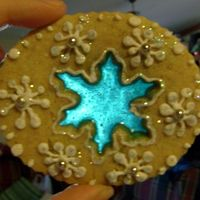 Snowflake Cookie   Cardamom cookie with candy center, RI and lots of glitter. TFL