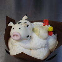 Marzipan Cow And Chicken On Bananas Foster Cupcake