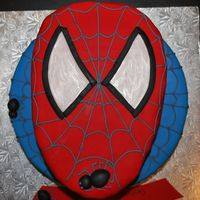 Superhero Spiderman Spiderweb Cake 2 tier cake. On the top I shaped the cake as Spiderman's head covered in red fondant. Bottom tier covered in blue fondant with...