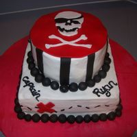 Pirate Cake  This is a pirate cake for a friend's 4th birthday. Buttercream with fondant details. 10 inch square and 6 inch round. The skull was...