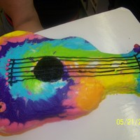 Tye Dyed Guitar Cake guitar cake for 10 yr old girl. all bc frosting, with jelly beans for the knobs.