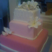 Pink Variations Three tier smple wedding cake with variations in pink. Tropical sugar flowers and some quilting