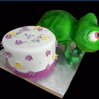Pascal Pascal from Tangled cake done for Kolbi, my most loyal customer who turned 7 this year! My husband used his new welder to construct a frame...
