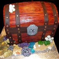 Treasure Chest Treasure cake done for the birthday of a repeat customer (she ordered the Chihuahua cake last year)... I like those :)Cake is 8 layers of...