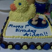 1St Birthday Duck Cake W/cupcakes I made this cake for my friend's son's 1st birthday, who had a duck theme. Both cakes are all buttercream. I decided to put the...