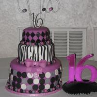 Sweet 16 Bday Cake  I made this cake for my niece's sweet 16 party. the bottom tier is a wasc cake filled w/raspberry and white chocolate bc. The middle...