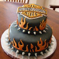 Harley Davidson Birthday Cake Two tier Harley Davidson cake; the first cake I ever made out of my own home instead of out of a bakery. I was nervous about that, but it...