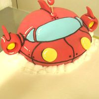 Little Einsteins Spaceship This is made out of cake, covered in fondant and sitting on a full-sheet cake.
