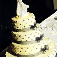Cristi And Jeb's Wedding Cake 1st Wedding Cake!!!!!4tier cake covered with buttercream icing. Decorated with edible silver pearls, wrapped in sheer indigo blue ribbion...