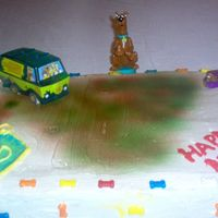 Scooby Doo Birthday Cake Marble cake with chocolate fudge filling.Buttercream icing.Instead of doing the usual borders, I used candy bones and decorated with scooby...