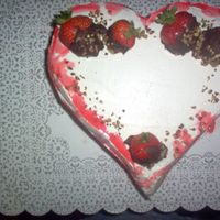 Lovers Heart Cake Valentine Double layer strawberry cake with fresh cut strawberries with strawberry glaze mixed. Covered with almond buttercream icing, chocolate...