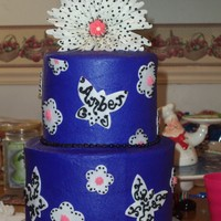 Niece's Birthday Cake My niece's 13th birthday cake. Fondant cut-outs, buttercream piping. Silk flower on top. The cake was deep purple, black, white and...
