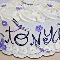 Dragon Flies And Rosettes For a friend....carrot cake, cream cheese icing. Stamped name, gumpaste dragon flies, royal icing flowers, and lots of rosettes.