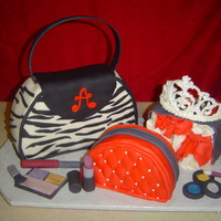 Got Purse, Make Up, Shopping Gag?! Pound cake covered in MMF, accents are made from MMF as well. Tiara is made from royal icing which I found the instructions here on cake...