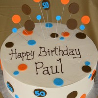 Mod Circle chocolate cake with vanilla buttercream, fondant accents,
