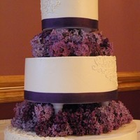 Lilac Wedding buttercream exterior, vanilla cake with white chocolate dipped strawberry filling, hand piping and fresh flowers. This is my 1st wedding...