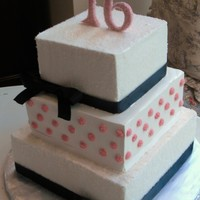 Black And White Sweet Sixteen buttercream icing with RI dots sprinkled with sadning sugar, top and bottom layers disted with sanding sugar for sparkle and texture,...