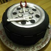 Truck Tire Grooms Cake fondant covered truck tire with chocolate molded tools, nuts, bolts. THanks to all the cc inspiration and help when I was stuck trying to...