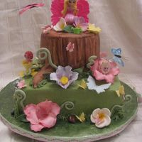 Thumbelina! I made this for my baby turning 3! Fondant, hand painted stump. Bottom is all buttercream, flowers are gumpaste! TFL