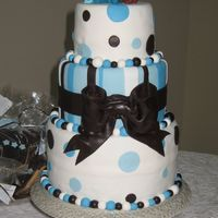 Brown And Blue Stripes And Dots Baby Shower Cake  This is the cake I made for my sister in law's baby shower.It was Devil's food and Marbled cake filled with ganache. I used MMF...