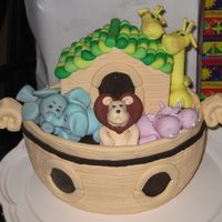 Noah's Ark Cake   Gumpaste animals on Ark shaped cake