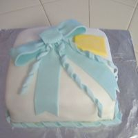 Wilton Course 3 Present Cake Just a simple present, but nice. Vanilla Cake w/ Cookies & Cream Filling