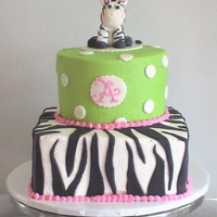 "Baby Zebra Stacked 8"" square and 6"" round for a dear friend's baby shower. The cake was designed to coordinate with the invitations and..."