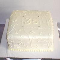 "35 Years 8"" square cake to celebrate 35th anniversary. I did small writing incorporated into the design of the cake to keep with the elegant..."