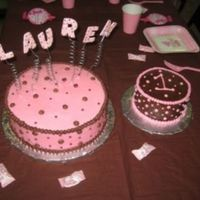 Lauren's Cake Large cake is strawberry marble with pink buttercream ans small cake is chocolate with chocolate buttercream. Letters are gumpaste.