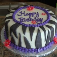 Zebra Birthday Birthday cake requested by a client. She wanted zebra, purple and pink and this is what I came up with. I am not pleased with my piping on...