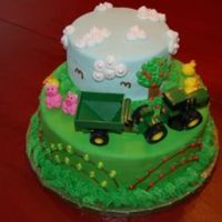 John Deere Cake First Birthday cake. Covered in MMF, gumpaste animals. Everything else is buttercream. Lots of fun to make!