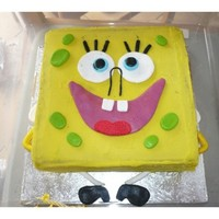 Sponge Bob Cake Banana cake covered in white chocolate ganache coloured yellow, decoration all in fondant. the colours mixed a bit, was a bit disappointed...