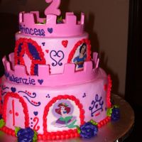 Castle Cake Two-tier cake iced buttercream, edible images of Disney princesses and fondant castle topper